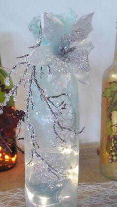 Wine bottle light decorated in blue Frozen organza, colors, bottle light, winter, Christmas glass bottle, wine decor, home decor by BurlapCreationsNC on Etsy https://www.etsy.com/listing/207915732/wine-bottle-light-decorated-in-blue