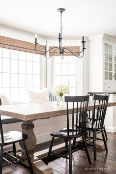 Looking to create a more kid-friendly space? This breakfast nook refresh features updates to add practicality for our family and cohesion with our renovated kitchen. #KitchenNook #BreakfastNook #NookRefreshIdeas