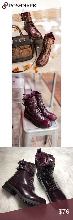 Embellished Ankle Combat Boots Studded shield design. Dark red synthetic leather upper. Decorative silvertone buckles Easy-on side zipper. Slightly lugged outsole You're the definition of edgy in This synthetic leather combat boots. A chunky block heel supplies this shoe with knockout style, right down to its sole. Shaft height: 6 in Shaft circumference: 10 in 1-1/2 in. block heel. Burgundy *Note: While this brand is owned by MIA and sold at Anthro, some Of these pieces can be purchased at…