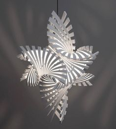 Artist Bathsheba Grossman has a great eye for beautifully symmetrical geometry. For more than twenty years, she has produced all kinds of complex, mathematical designs that she transforms into tangible objects through the technologically advanced process of 3D printing.
