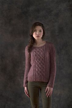 A fitted feminine pullover with exquisite cable and lace panels, Mori is worked in pieces and seamed.
