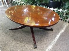 Vintage oval table with brass claws by Weiman Heirloom $125