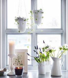 Gather white accessories by the window to create a simple and pretty window arrangement!