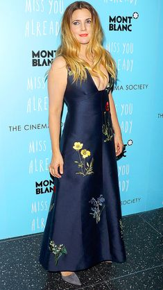 DREW BARRYMORE in a plunging black dress with floral detailing, plus delicate jewels and a bright red lip, at a screening of Roadside Attractions in N.Y.C.