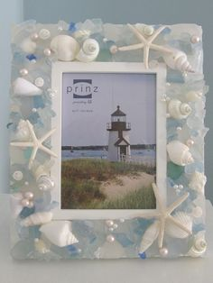Shell Frame.  This is not hard to make into your own creation. Just some seashells and a frame few scattered pearls. Lovely.