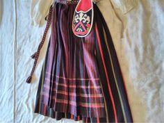 Traditional costume from Hassela, size 42 wide-seam and pleats. Blouse, vest dress, apron, shawl, Harta (cap), bags, brooches and cufflinks. 2/3