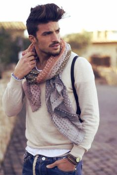 Interesting use of scarf over a simple cream jumper.
