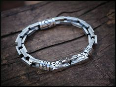 Check out this item in my Etsy shop https://www.etsy.com/listing/532380511/bracelet-wolfs-for-men-by-franguejewelry