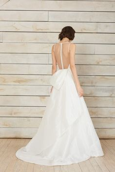V-neck fit to flare taffeta gown, illusion back with covered buttons and large origami bow