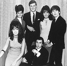 U.K. photo, 1960s, from top left: Nedra Talley, Tony King (Decca Records, U.K.), Estelle Bennett, Beatle George Harrison, Ronnie Bennett, and Phil Spector.