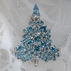 Vintage Inspired Swarovski Crystal Christmas Tree Brooch Pin, Christmas Gift, Xmas Tree, Blue Rhinestone Silver Tree. $19.99, via Etsy.
