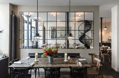 """""""I wanted to liberate good French food from expensive hotel dining rooms,"""" young chef Bertrand Grébaut, whose three-year-old restaurant Septime is one of the most sought-after reservations in Paris, told The New York Times. This explains the bohemian look he created in a former furniture workshop in eastern Paris. The twin dining rooms have polished anthracite-color cement floors, sleek Danish-modern chairs, and tables made from rough gray recycled wood. And there's often a bouquet of…"""