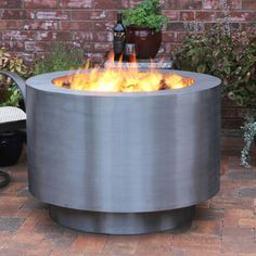 http://www.woodlanddirect.com/Outdoor/Fire-Pits-Gas-Custom-Artisan/Arco-Fia-38-Stainless-Steel-Gas-Fire-Pit
