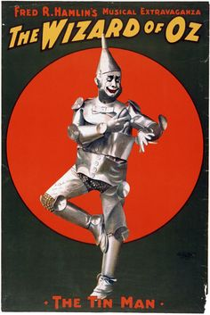 "A theater poster for ""Fred R. Hamlin's Musical Extravaganza, The Wizard of Oz,"" showing the Tin Man. Created by ""The U.S. Lithograph Co., Russell-Morgan Print, Cincinnati & New York,"" 1903. A signature on the Tin Man's leg reads: ""To Spider Rathburn, now I'm oil-right. Dave Montgomery by Fred Stone. Jan. 14, 1936."""