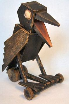 Wooden crow pull toy. One of a kind and when pulled his head goes side to side and is mouth opens and closes. He was exhibited at the Museum of American Folk Art in 1975