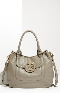 Tory Burch - have it in yellow. Best bag EVER! Love this color though.