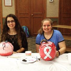 Teen volunteers painted & decorated pumpkins to be donated to First Company Pink. Pictured here - Amanda & Rebecca.