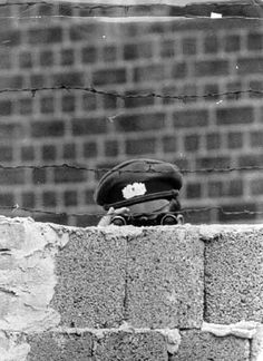A GDR soldier keeps a watchful eye over the Berlin Wall in the 1960's    #Berlin #GDR #BerlinWall