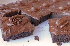 """Fudge brownies are rich and packed with chocolate! No cake style here! Iced with fudge icing or the more """"adult"""" ganache icing. Fudge Brownies are the best!"""