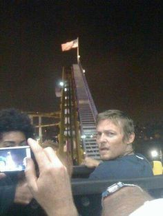 Norman Reedus, poor guy can't even get on a roller coaster without someone taking a pic. of him...