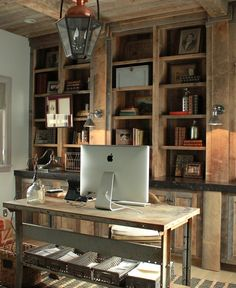 I really like how the flat columns on the bookcase line up iwth the beams in the ceiling.  It feels rustic but intentional and classic at the same time.  Home office by Decor de Provence