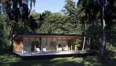 Designed by Christensen & Co. Architects in conjunction with Pernille Poulsen, this Summer Cottage In Denmark is a canopied timber structure measuring only 689 square feet but because of its de… Contemporary Cottage, Modern Cottage, Cottage Design, House Design, Denmark House, Modern Wooden House, Forest House, Prefab Homes, New Home Designs