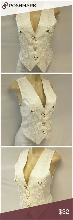 """Offers of 40% Less on BUNDLES Always Accepted! MILAND FASHION, Made in USA, Brocade Embellished Vest, size Medium See Measurements, 3 floral buttons, 5 silky rosettes, semi-sheer back with self-tie, lightweight soft material, 40% rayon, 60% acetate, approximate measurements: 22"""" length front to pointed hemline, 17.5"""" length back. ADD TO A BUNDLE! Offers of 40% Less on BUNDLES Always Accepted! Miland Fashion Jackets & Coats Vests"""