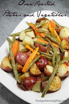 Oven Roasted Potatoes and Vegetables are a flavorful yet simple side dish. All you need are potatoes, carrots, green beans and 1 secret everyday ingredient