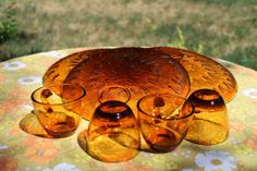 Hey, I found this really awesome Etsy listing at https://www.etsy.com/listing/151797923/1950s-sunburst-amber-glass-luncheon