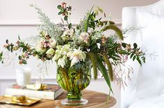 Snowberry, blushing bride protea, artemisia, foxtail millet, northern sea oats, and jasmine make this romantic bouquet.