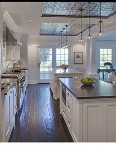 Kitchen ceiling design above island. Pressed tin tiles in kitchen. Tin ceiling tiles from the American tin ceiling company. Kitchen ceiling design above island ideas. Kitchen ceiling design above island. Dark Countertops, Home Decor Kitchen, Spacious Kitchens, Kitchen Ceiling Design, Rustic Farmhouse Kitchen, Kitchen Remodel, Kitchen Styling, Kitchen Cabinets Makeover, Kitchen Design
