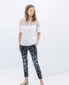 Image 1 of TECHNICAL PRINT FABRIC TROUSERS from Zara