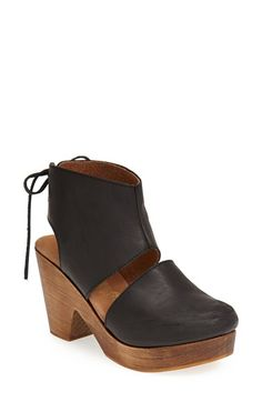 Free shipping and returns on Free People 'Desert Gold' Clog (Women) at Nordstrom.com. A wood-grained platform and bold lace-up cuff amplify the vintage attitude of an earthy demi-wedge clog.