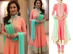GET THIS LOOK: Madhuri Dixit - Nene looks elegant in this peach zari embroidered anarkali set by SVA.  Shop the designer now at: http://www.perniaspopupshop.com/designers-1/sva #madhuridixit #sva #celebritystyle #anarkali #coral #elegance #amazing #style #trends #perniaspopupshop #happyshopping