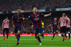 Lionel Messi wheels away after opening the scoring with a brilliant solo effort in Barcelo...