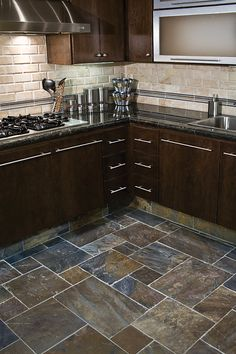 love the cut if the tile floors and the one pane non framed cabinets!!! so sleek…