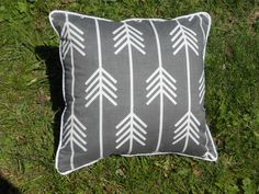 A personal favorite from my Etsy shop https://www.etsy.com/listing/235738911/arrow-pillow-grey-and-white