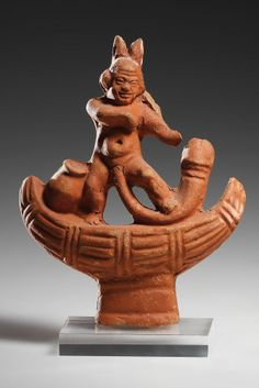 A Pataikos with Phallos on a Reed Boat  H. 12.3 cm. Orange clay, red slip Roman Egypt, 1st-2nd cent. A.D.