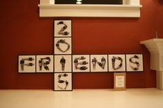"""8th grade art auction piece (2014). Photography taken from above of students to spell """"friends 2015"""". Photos turned to black and white. Using mod-podge, glued it onto wood frame that was painted black."""