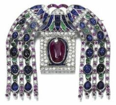 A great example of the Egyptian trend in Art Deco! This brooch, made in the mid 1920's by Cartier, New York, epitomises the purest Art Deco style. This brooch is made in platinum and set with cabochon sapphires, emeralds and a central ruby.