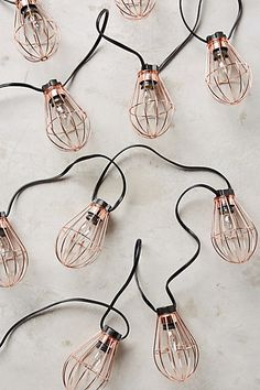 Caged Bulb String Lights, great for outdoor entertaining #anthropologie