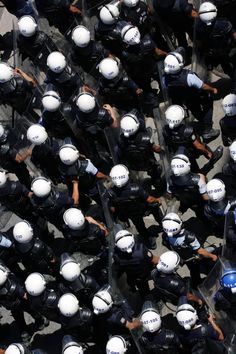 Riot police ready to enter Taksim. Here, the helmet numbers are visible; later, police began to conceal these numbers with tape so as not to be identified.