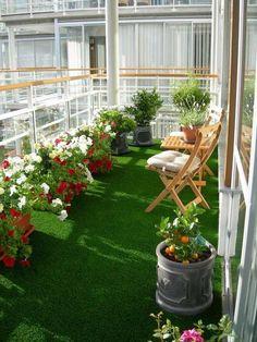 beautiful balcony garden flower pots wooden furniture green floor rug