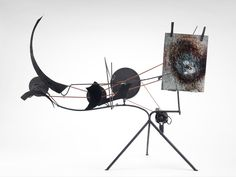 Jean Tinguely, Metamatic No. 9, 1958, Round rubber belt, steel rods, painted sheet metal, wire wooden pulleys, two clothes pins and electric motor, 35-1/2 x 56-5/8 x 14 1/4. Museum of Fine Arts, Houston. Gift of D. and J. de Menil.