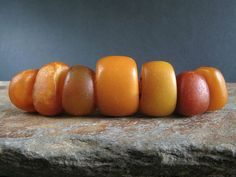 7 ANTIQUE NATURAL AMBER beads. MOROCCO
