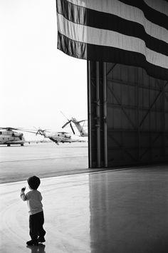 A child waiting at an Air Force base in California for his father -- a SEAL deployed to Afghanistan -- to return home.