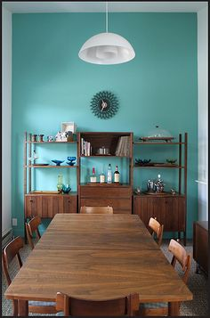 mid-century modern wood furniture with a pop of color. Love