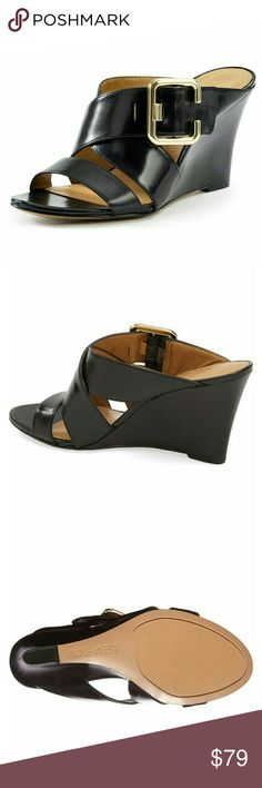 New! Nine West Buckle Leather Wedge Sandals NWB An earthy stacked wedge boosts the summer-ready style of a cross-strap sandal detailed with an oversized, polished buckle.  Brand New With Box   Classic wedge with a cross strap and gold-tone buckle detail  3 inch heel  Slip on  Adjustable strap with buckle closure  Leather upper/synthetic lining and sole Nine West Shoes Sandals