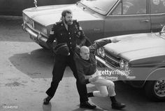 A police officer detains a skinhead in Southend-on-Sea, Essex, April Get premium, high resolution news photos at Getty Images Essex Police, Skin Head, Cops, Police Officer, Image, Gotham, British, Google Search, Shaved Heads