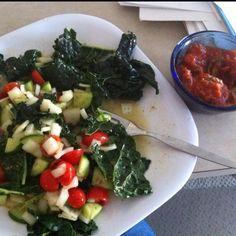 Lunch: kale with organic tomatoes, onion, mini cucumbers, rice vinegar and EVOO. Side of jalapeños toppe with Rao's organic Marinara sauce. YUM!!!